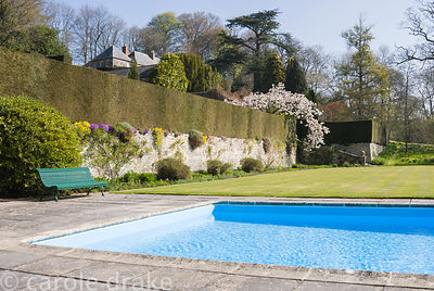 Swimming pool added to the garden in 1967, with terraces rising behind constructed in the early 20th century, and the great w...