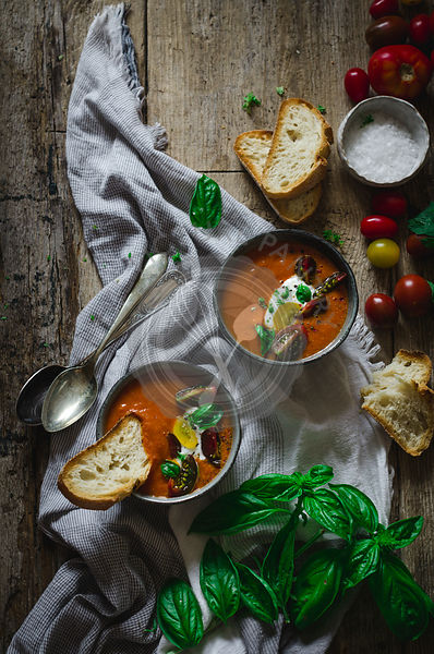 Fresh, homemade tomato soup on a rustic wooden table