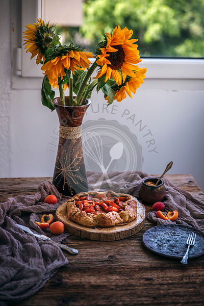 Rustic apricot galette on a wooden table