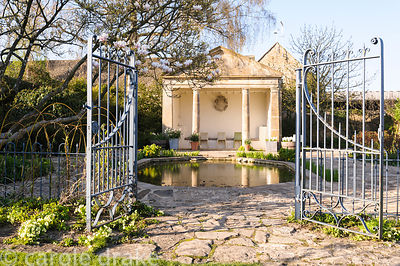 The Temple, from demolished Fairford Park, is used as a summerhouse beside the pond at Barnsley House, Cirencester, Glos, UK