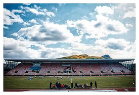 The old main stand at Meadowbank Stadium, overlooked by Arthur's Seat.