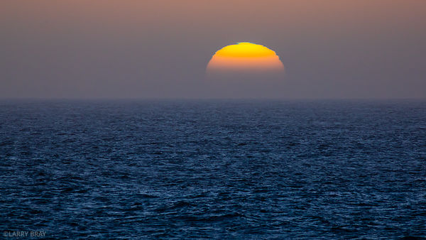 Sun with green flash in Atlantic Ocean off the coast of Africa