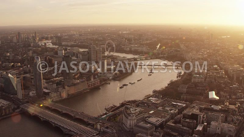 Aerial footage of the Strand, River Thames, Westminster, Southbank, London Eye at sunset, London.