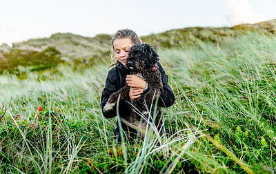 Girl and dog in Nationalpark Thy
