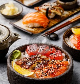 Sushi set and Sashimi Rice bowl with Tuna and Salmon on gray table