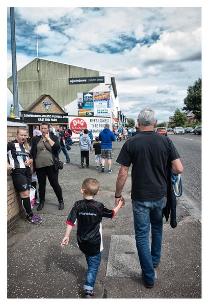Dunfermline Athletic fans on way to first match of season at East End Park.