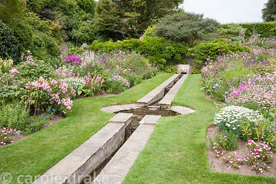 The Rill Garden with hard landscaping by Oswald Milne, orignally planted with roses, now a vibrant display of pastel colours ...