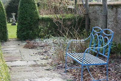 Blue painted metal bench at the Old Rectory, Netherbury in January