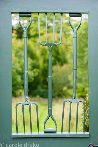 Door from the walled garden with hand forks at Broadwoodside, Gifford, East Lothian
