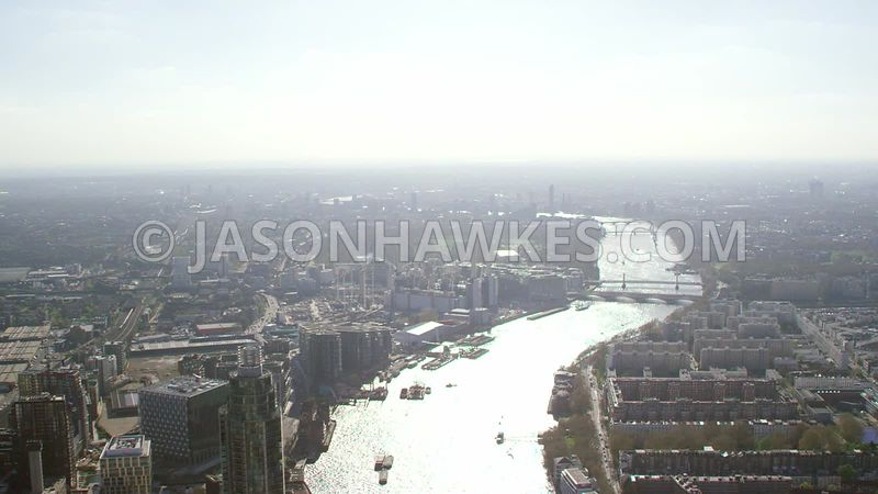 Aerial footage of the River Thames, Nine Elms and Pimlico, London.