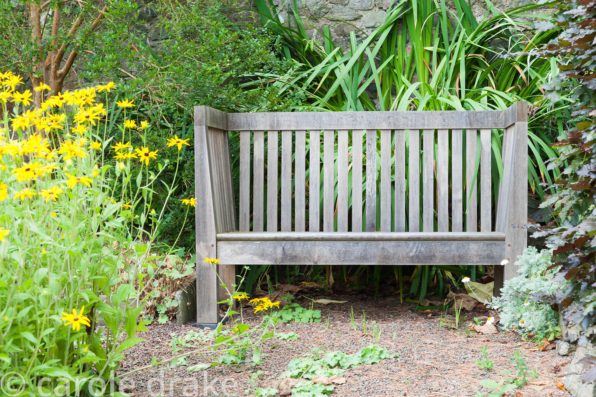 Arts and Crafts inspired oak bench designed by the owner Gillian Archer. Perrycroft, Upper Colwall, Herefordshire, UK
