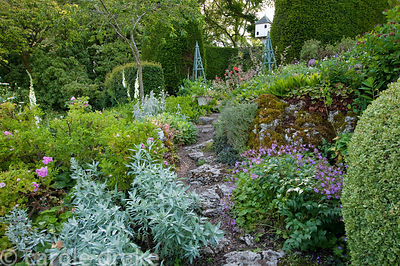 Rock garden dating from the 1930s planted with artemisia, hardy geraniums and stachys. Mindrum, nr Cornhill on Tweed, Northum...