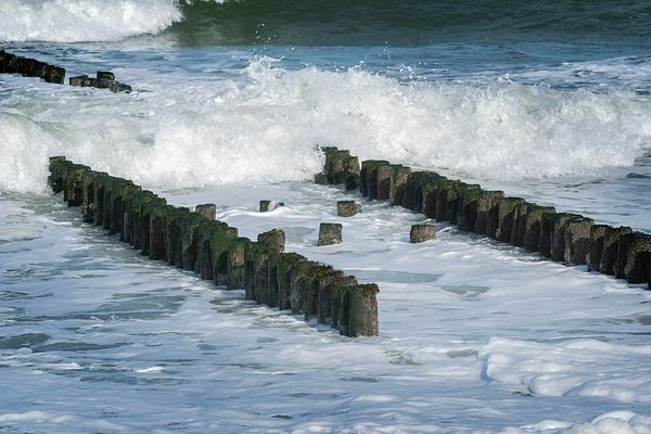 Breakwater and breaking waves