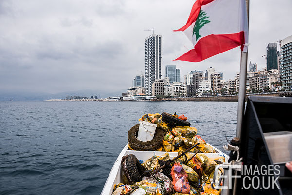Calypso Dive Club members seen here clearing trash from the sea along Beirut's Corniche. Lebanese people came out en masse Su...