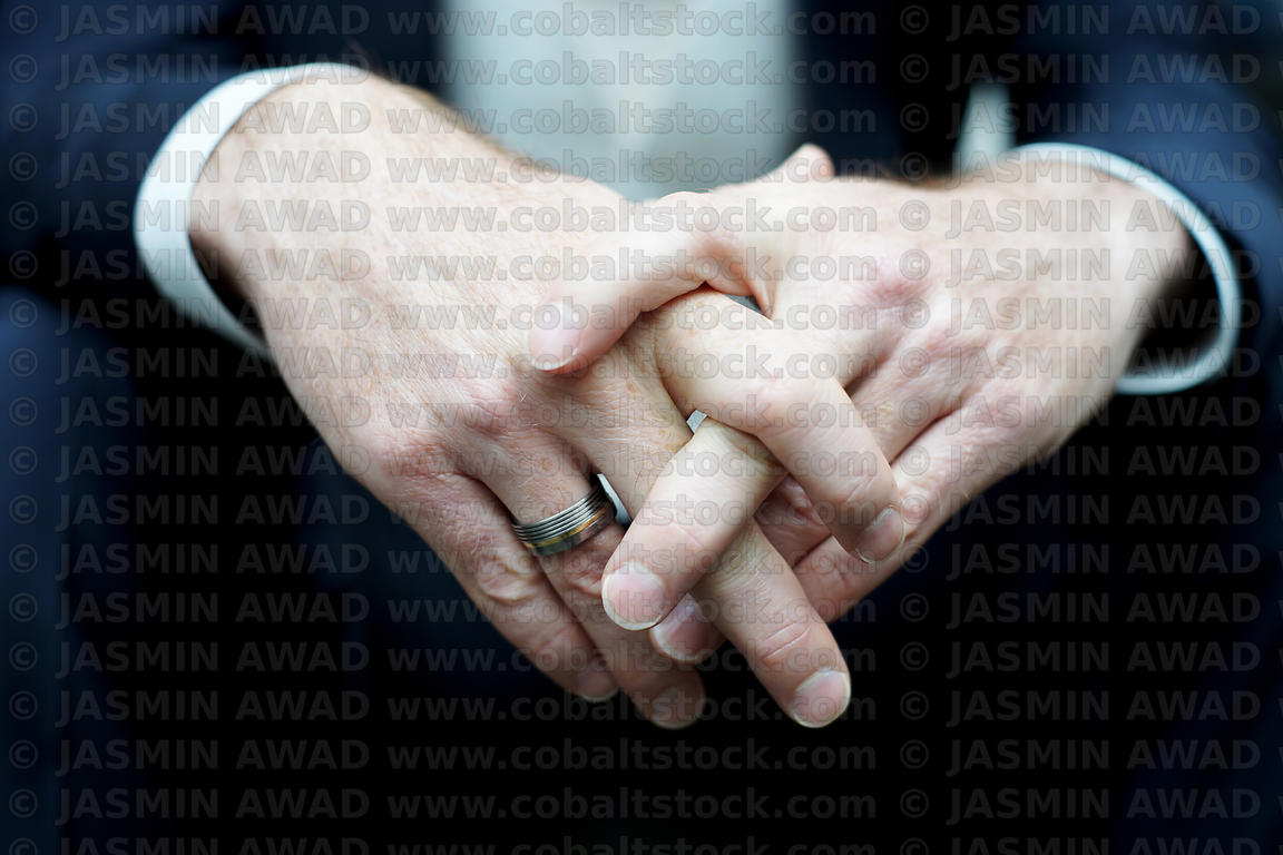 Male hands with wedding rings