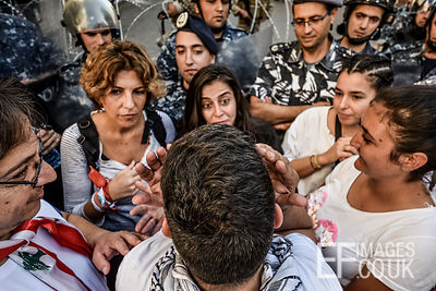 Women form a barricade between angry male protesters and police lines protecting Parliament. Protesters in Beirut successfull...