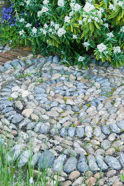 Pebble spiral. Private garden, Dorset, UK