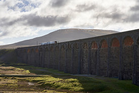 A train crossing the Ribblehead Viaduct in the Yorkshire Dales,