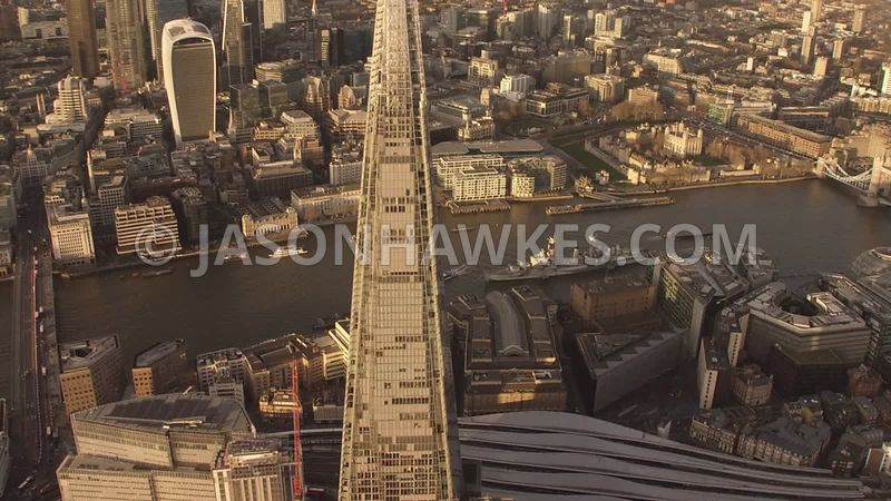 Aerial footage of the Shard, River Thames, at sunset, London.