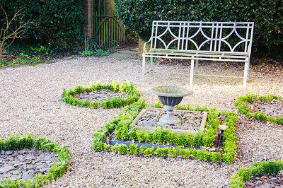 New euonymus hedges have recently replaced box in the front garden surrounding a decorative urn. Windy Ridge, Little Wenlock,...