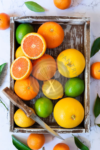Organic citrus fruit in a wooden tray.