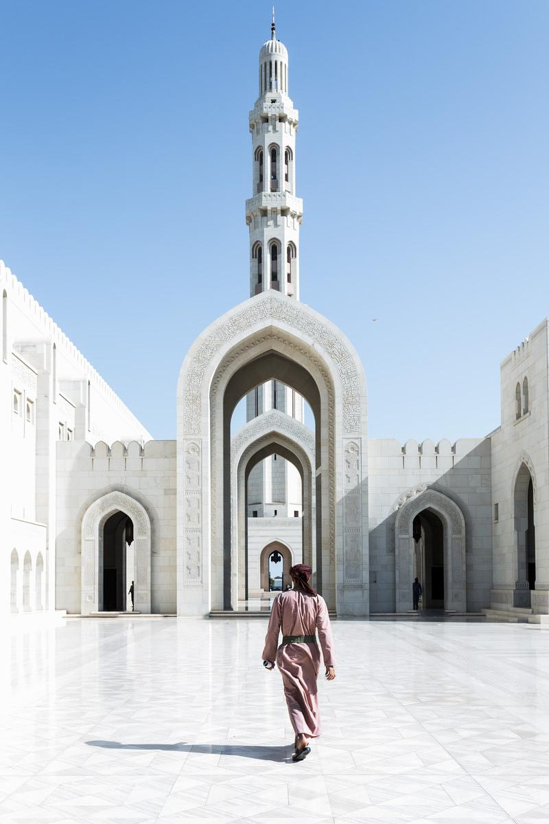 Sultan Qaboos grand mosque with local man, Muscat, Oman