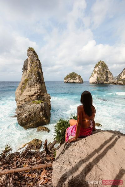 Woman enjoying Diamond beach, Nusa Penida, Bali