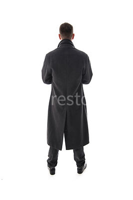 A Figurestock image of a mystery man in a long black winter coat, looking away – shot from eye level.