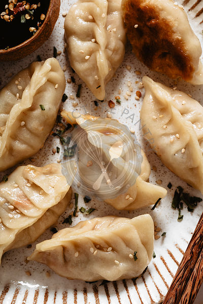 CLoseup of potstickers with chicken