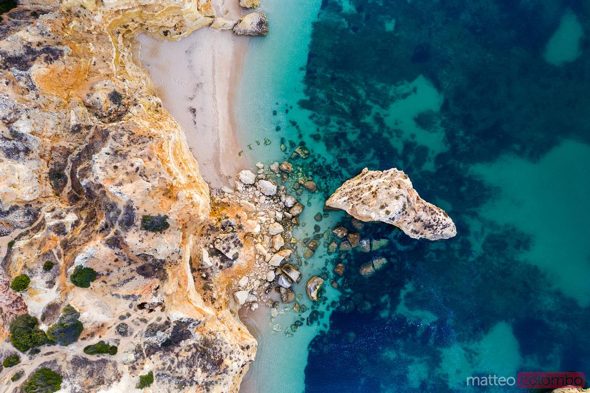 Overhead view of rock formations and sea, Algarve, Portugal