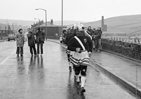 #77102,  The 'Nutters' Dance', Bacup, Lancashire,  1973.  On Easter Saturday every year the 'Coconut Dancers' gather at one b...