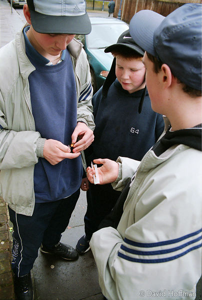 Teenagers from Dave Adams house, a childrens' home in Tower Hamlets drinking alcopops & smoking cannabis.