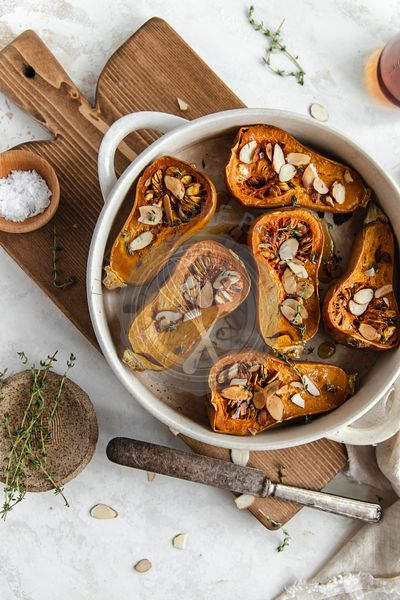 Roasted honeynut squash with maple syrup and sliced almonds.