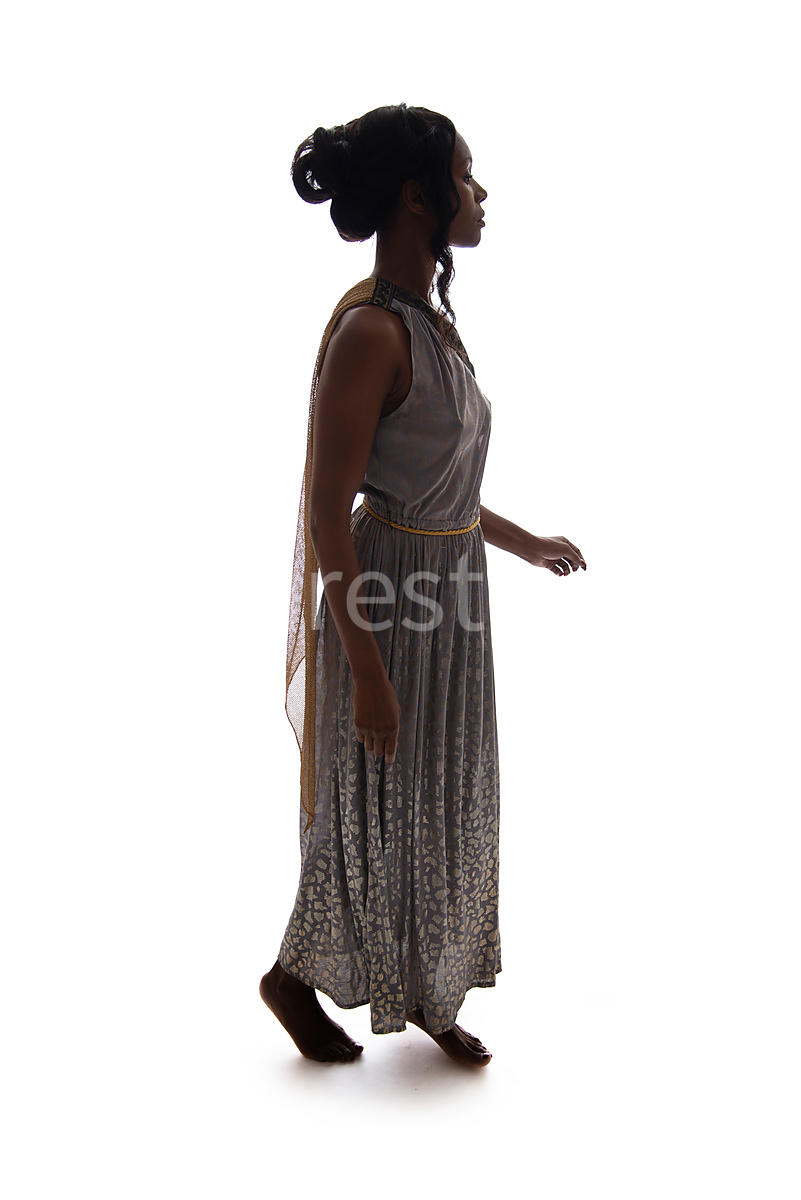 A semi-silhouette of a barefoot Roman woman in a dress – shot from eye level.