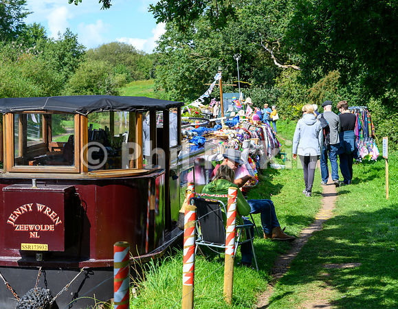 Visitors enjoy the good weather at the Whitchurch Canal Festival in Shropshire.