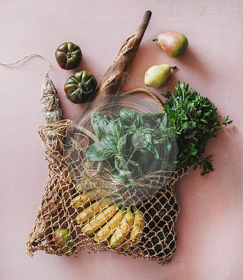 Flat-lay of eco-friendly bag with fresh ingredients and sausage
