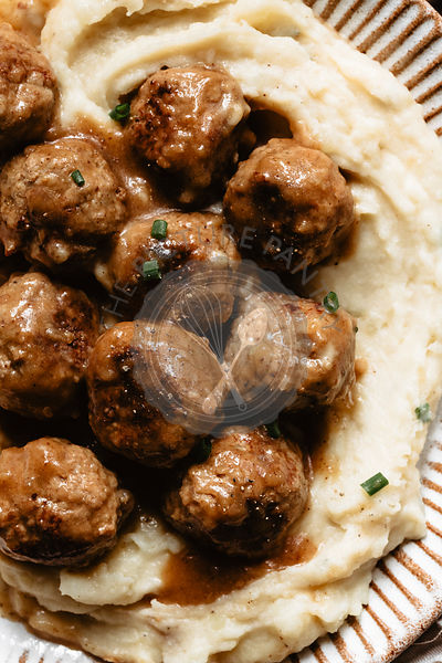 Closeup of mashed potatoes and meatballs on a plate