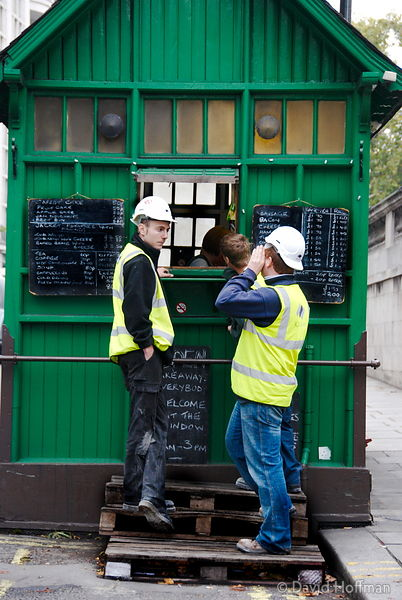 071026_SIOE_177 Workmen take a break at a street cafe in a hut at Temple, London 2007.
