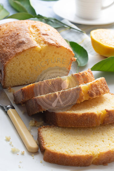 Freshly baked orange loaf cake cut into slices.