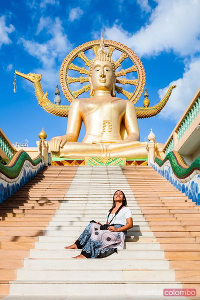 Female tourist visiting the Big Buddha temple, Ko Samui, Thailand
