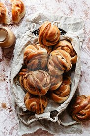 Multiple cinnamon buns in a basket