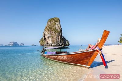 Beautiful woman relaxing on longtail boat, Railay, Thailand