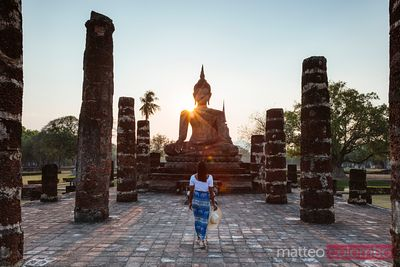 Asian woman visiting Wat Mahathat, Sukhothai, Thailand