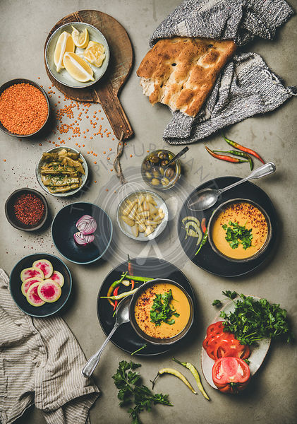 Turkish traditional lentil soup Mercimek over concrete background, top view