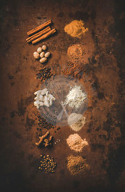 Turkish spice mix Yedi Bahar mix over rusty background