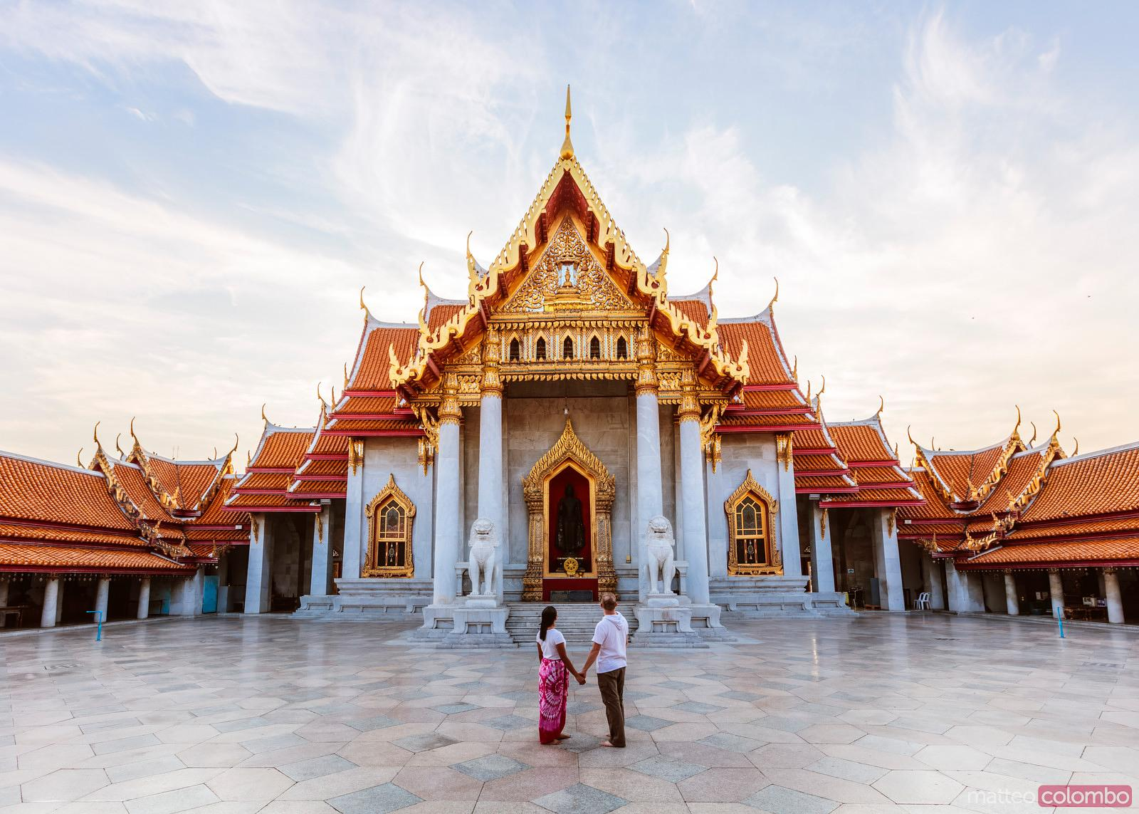 Tourist couple visiting the Marble Temple, Bangkok, Thailand