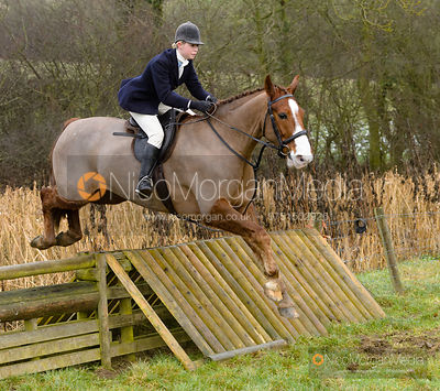 Marina Bealby jumping a hunt jump at Peakes - The Fitzwilliam Hunt visit the Cottesmore at Burrough House