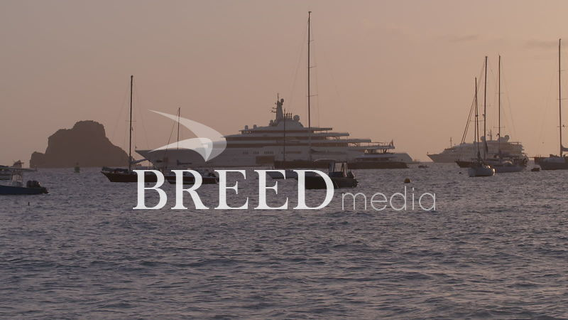 BMS001_011_HD_25fps_Superyacht_and_sailing_yachts_anchored_by_Island