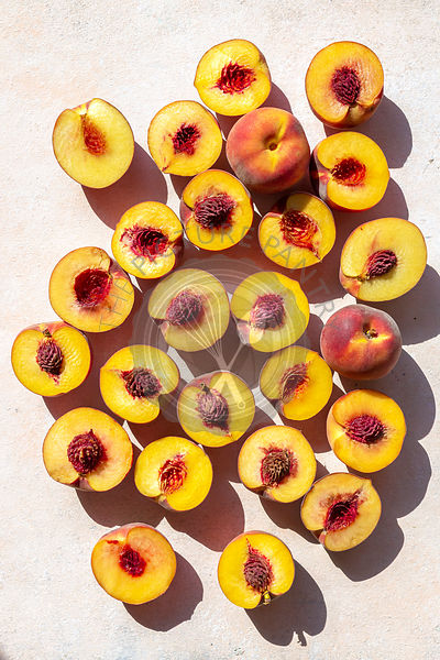 Sliced peaches on the table,top view