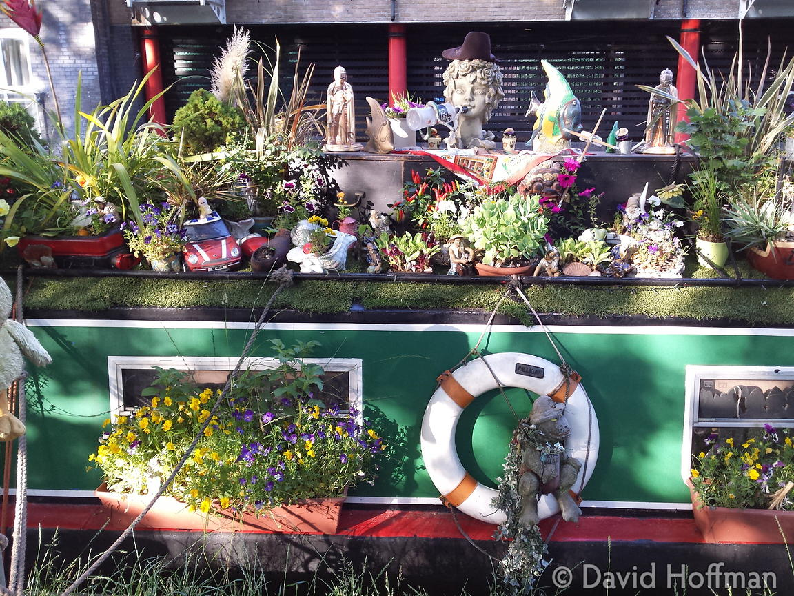 2015-06-25 19.07.56 Flowers cover a barge on the Regents Canal, Hackney, London.
